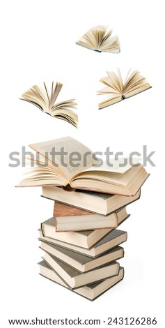 Old book pile and books flying away isolated on white background - stock photo