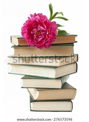 Old book pile and peony isolated on white background. Teacher's day concept - stock photo