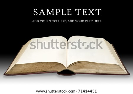 Old book with blank page on black color background - stock photo