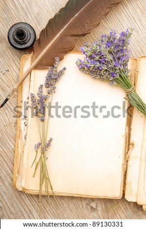 Old book with lavender flowers - stock photo