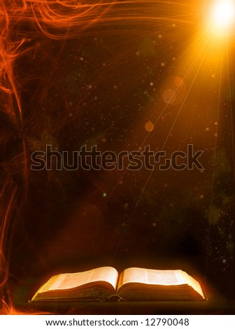 Old book with Ray of light - stock photo