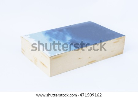 Old book with spread blue cover on white background