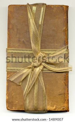 old book wrapped up ribbon - stock photo