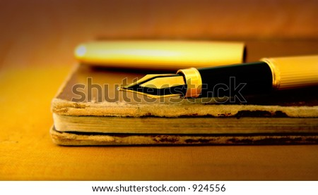 Old books and fountain pen, processed colors - stock photo