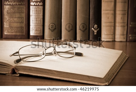 old books and glasses. vintage style - stock photo