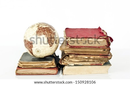 Old books and globe earth on white background - stock photo
