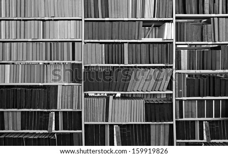 Old books and journals in library  - stock photo