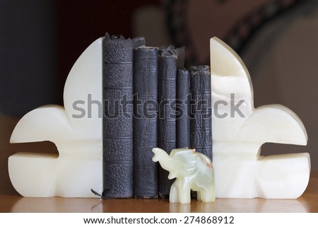 Old Books Between Onyx Stone Bookends