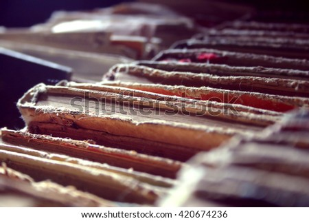 Old Books Covered With Dust. Background. Shallow depth of field and selective focus - stock photo
