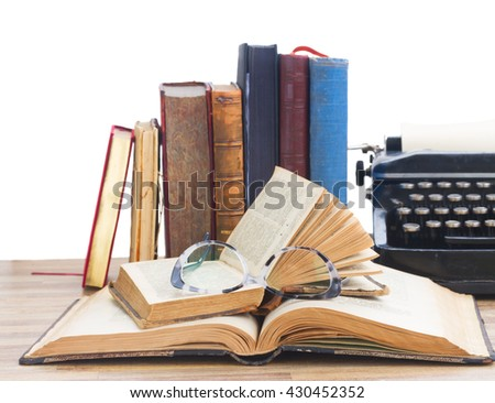 Old books, glasses and typewriter over white background - writting and publishing concept - stock photo
