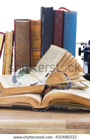 Old books, glasses over white background - writting and publishing concept - stock photo