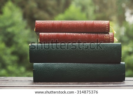old books in a garden table  - stock photo