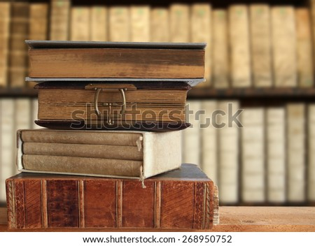 old books in a library - stock photo