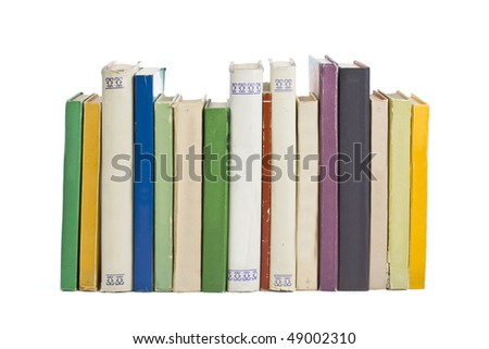 Old books in a row, all hardbacks some with leather covers - stock photo
