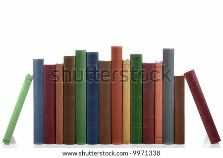 Old books in a row, all hardbacks some with leather covers. Isolated on white with slight shadow. - stock photo