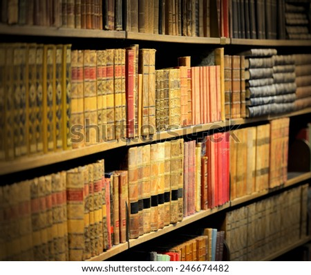 Old books in library - stock photo
