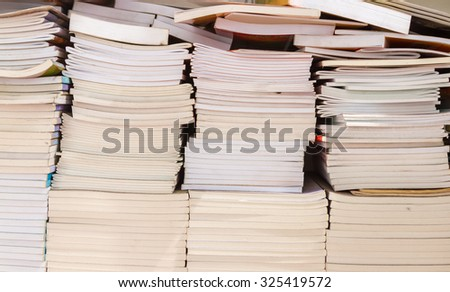Old books in the Library for reading on background. - stock photo