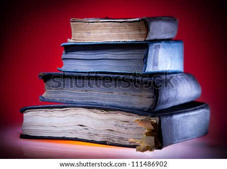 Old books, mystical red light  background - stock photo