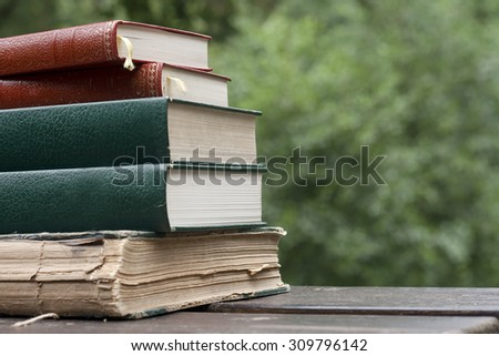 old books on a garden table  - stock photo