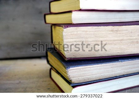 old books on a table - stock photo
