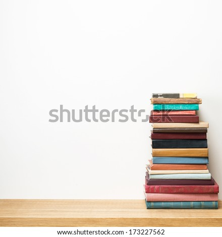 Old books on the shelf. - stock photo