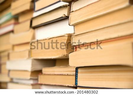 old books on the shelf - stock photo