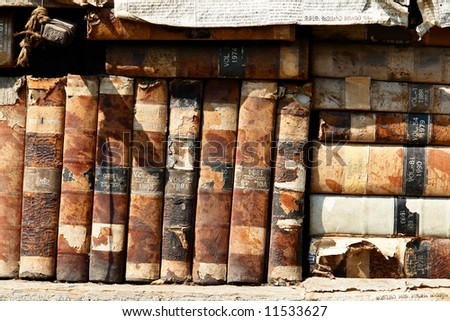 Old books on the shelves. - stock photo