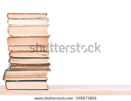 Old books on wood shelf. - stock photo