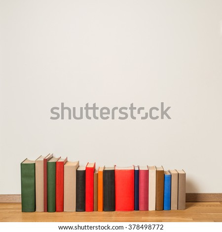 Old books on wooden floor - stock photo