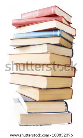 Old books pile isolated on white background - stock photo