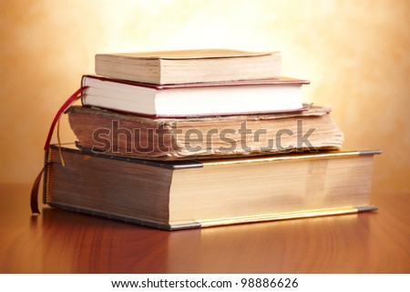 Old books pile on the wooden table - stock photo