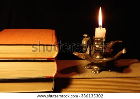 old books with candle