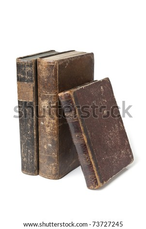 Old books with wear and tear isolated on white background
