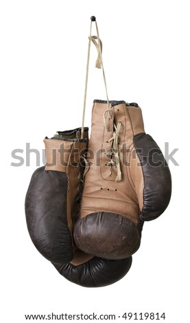 Old boxing gloves hanging on a lace - stock photo