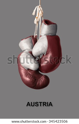 old Boxing Gloves in the Color of Austria - stock photo