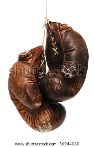 old boxing gloves isolated over white - stock photo