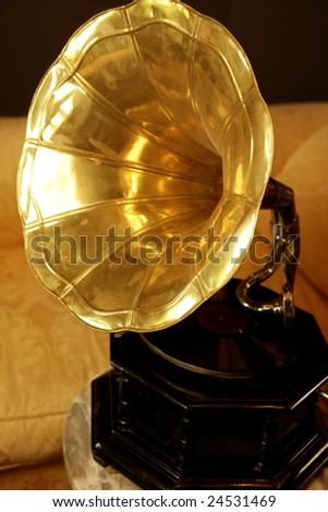 Old brass golden gramophone, his masters voice - stock photo
