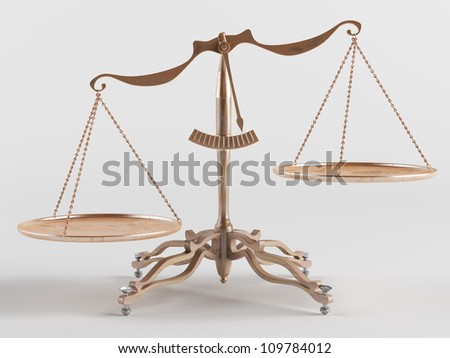 Old brass scales are tilted in one direction - stock photo