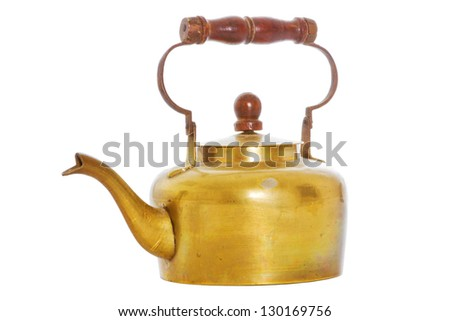 Old brass tea kettle over a white background - stock photo