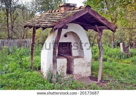 Old bread oven  in the courtyard - stock photo
