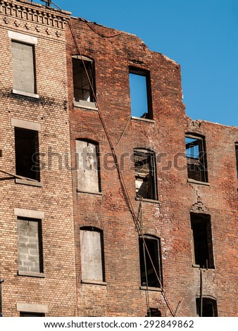Old brick apartment buildings being demolished in New York City. - stock photo