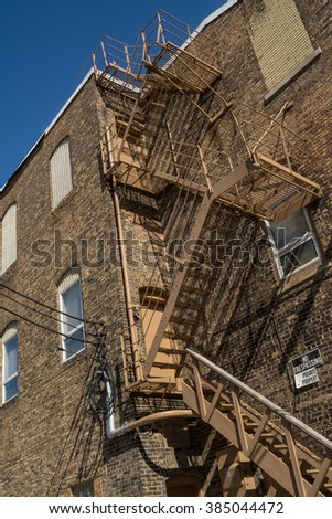 Old brick building with fire escape in small Midwest town, LaSalle, Illinois. - stock photo