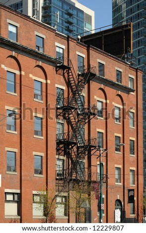 Old Brick Building With Fire-Escape Stairs