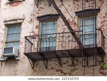 old brick building with fire escapes in front, Manhattan, New York