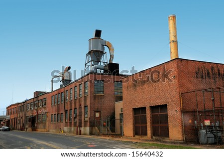 Old brick Factory on a gloomy day - stock photo