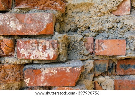 Old brick masonry wall. Texture of wall from a red brick. The background of bricks. Brickwork of an ancient building. - stock photo