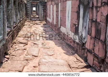 Old brick walk way in sunlight - stock photo