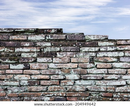 Old brick wall and sky background - stock photo