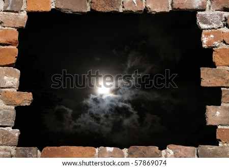 Old brick wall as a grungy frame with night heaven - stock photo