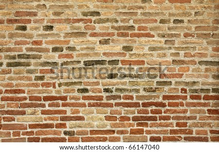Old brick wall as backgroud - stock photo